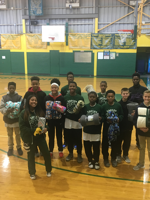 "FHSA basketball players donate blankets to the ""Van"" project! 💚💛💚🏀"